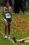 Wilson's Andi Hall (#449) is surprised to see a downed runner in the varsity girl's 5K race. The PIL Cross Country District Meet was held at Grant High School...