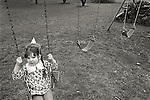 Carey Cross with birthday hat on swing, Hepburnville, PA.