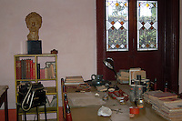 """Coyoacan, Mexico City - Leon Trotsky's study in his house in Mexico City.  The Leon Trotsky House Museum is a venue honoring Leon Trotsky's life.  The venue displays memorabilia such as photographs, newspapers and Trotsky personal effects.  The site also houses an organization that works to promote political asylum.  The museum is a favorite destination of millions of tourists every year, and it is located in the Coyoacan borough of Mexico City.  The museum was built next to the house in which Trotsky lived with his second wife Natalia Sedova from 1939 to 1940, and where the Russian dissident was also murdered and buried.  The house has been preserved as it was at that time where Trotsky lived there, in particular the study in which Joseph Stalin' supporter Ramon Mercader killed Trotsky with an ice axe to the back of the head.  Around the house is a garden and high walls with watchtowers.  The complex was turned into the current museum and asylum institution in 1990, on the 50th anniversary of the assassination.  Coyoacan's name comes from Nahuatl it likely meaning """"place of coyotes"""".  Hernán Cortes and the Spanish conquistadors used this area as a headquarters during the Spanish conquest of the Aztec Empire. They also made it the first capital of New Spain between 1521 and 1523.  In recent times, has been a counterculture hotbed and where Frida Kahlo and Diego Rivera lived, a few blocks away from Leon Trotsky.  Due the historic and cultural relevance, their homes are now the Frida Kahlo Museum and the Leon Trotsky Museum, which are visited by thousands of tourists every year.  Modern-day Coyoacan is a quiet residential area with cobblestone streets, restaurants, parks, squares, and a favorite hangout for bohemia enthusiasts. Photo by Eduardo Barraza © Copyright"""