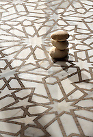 Castilla, a handmade mosaic shown in honed Jura Grey and polished Calacatta Tia, is part of the Miraflores Collection by Paul Schatz for New Ravenna.<br />