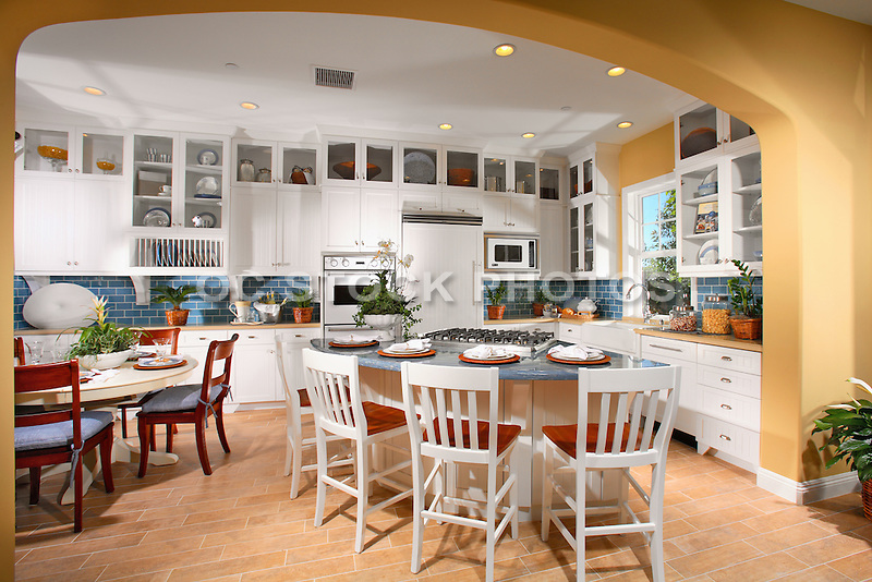Model home kitchen with white cabinets and tile flooring for Model kitchens with white cabinets