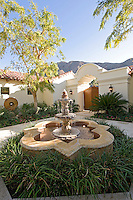 Courtyard garden featuring beautiful fountain