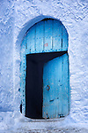 Traditional entrance door in the medina of Chefchaouen, Morocco.