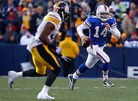 ORCHARD PARK, NY - NOVEMBER 28:  Ryan Fitzpatrick #14 of the Buffalo Bills runs out of the pocket with the ball during the game against the Pittsburgh Steelers on November 28, 2010 at Ralph Wilson Stadium in Orchard Park, New York.  (Photo by Jared Wickerham/Getty Images)