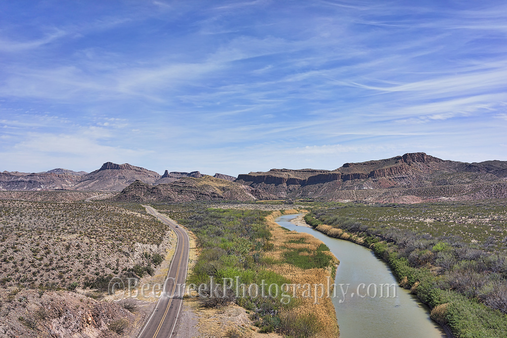 Distant aerial view of Big Bend State Park as the Rio Grande and the River road run side by side into the mountains of west Texas.