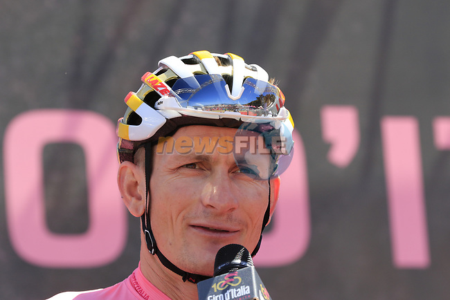Race leader Maglia Rosa Andre Greipel (GER) Lotto-Soudal at sign on in Arbatax before the start of Stage 3 of the 100th edition of the Giro d'Italia 2017, running 148km from Tortoli to Cagliari, Sardinia, Italy. 7th May 2017.<br /> Picture: Eoin Clarke | Cyclefile<br /> <br /> <br /> All photos usage must carry mandatory copyright credit (&copy; Cyclefile | Eoin Clarke)
