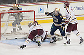 Sam Herr (ND - 12) skates past the BC net to celebrate another Irish goal. - The visiting University of Notre Dame Fighting Irish defeated the Boston College Eagles 7-2 on Friday, March 14, 2014, in the first game of their Hockey East quarterfinals matchup at Kelley Rink in Conte Forum in Chestnut Hill, Massachusetts.