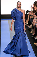 Hanna R walks runway in a cyan blue faille exaggerated one shoulder draped trumpet gown, by Monique Lhuillier, from the Monique Lhuillier Spring 2012 collection fashion show, during Mercedes-Benz Fashion Week Spring 2012.