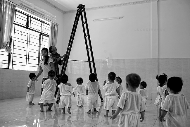 "Dozens of ""saved"" children roam the halls of an orphanage outside of Nha Trang. Their mothers were talked out of abortions but they did not want to keep them."
