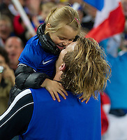 Rugby World Cup Auckland  England v France  Quarter Final 2 - 08/10/2011.AURÉLIEN ROUGERIE (France) celebrates victory over England with his daughter.Photo Frey Fotosports International/AMN Images
