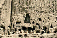 A four metres statue of Buddha surround by Buddhist monasteries temples and habitations on the left side of the 34 meters giant Buddha in Bamiyan.