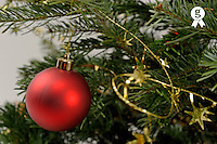 Red bauble on Christmas tree, close-up (Licence this image exclusively with Getty: http://www.gettyimages.com/detail/89955781 )