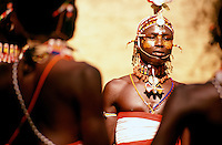 Samburu ilmurran or young warrior. The Samburu are a pastoral, nomadic people who live in northern Kenya.  Their customs, language, and traditions are very similar to the more well known and legendary Maasai of Central and Southern Kenya, and Northern Tanzania