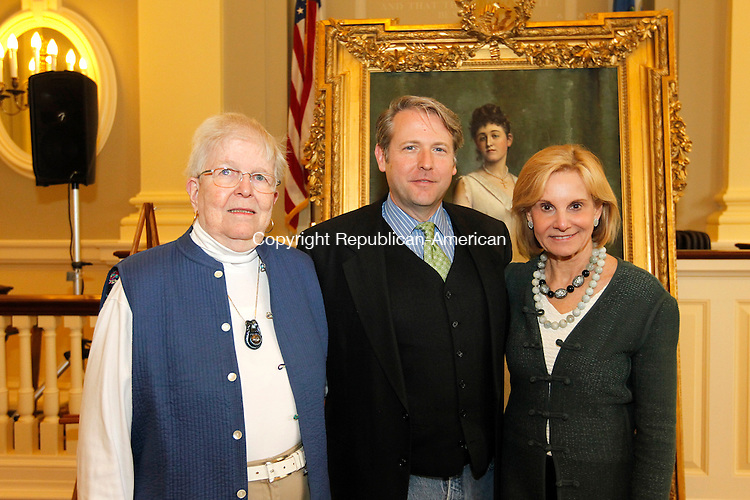 Waterbury, CT- 19 May 2013-051913CM10-  SOCIAL MOMENTS--- Left to right, Barbara Munger of Southbury, Bob Burns, Director of the Mattatuck Museum and Cathy Smith, of Middlebury photographed during Mattatuck Museum's celebration of the restoration of the Carrie Welton portrait inside City Hall in Waterbury Sunday afternoon.   Christopher Massa Republican-American