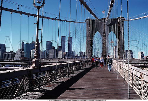 NEW YORK's MANHATTEN skyline viewed from the Brooklyn Bridge 9610 Photo:Julian Ravilious/Action Plus...1996.Travel.USA.city.cities