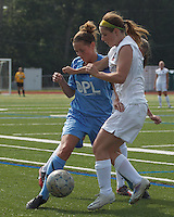 Seacoast United Mariners midfielder Taylor Littlefield (5) works to clear ball as Boston Aztec forward Brittany Russo (3) defends. In a Women's Premier Soccer League (WPSL) match, Boston Aztec (white) defeated Seacoast United Mariners (blue), 2-1, at North Reading High School Stadium on Arthur J. Kenney Athletic Field on on June 23, 2013. Due to injuries through the season, Seacoast United Mariners could only field 10 players.