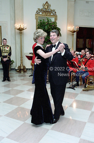 In this photo provided by the Ronald Reagan Presidential Library, United States President Ronald Reagan dances with Princess Diana in the Cross Hall of the White House in Washington, D.C. at a Dinner for Prince Charles and Princess Diana of the United Kingdom on November 9, 1985.<br />