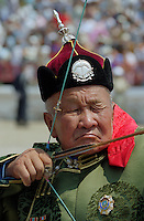 Ulaanbaatar, Mongolia, July 2003..Competitors in the archery contests in the national Naadam at Ulaanbaatar central stadium.