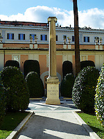 The Palazzo Colonna is a palatial block of buildings in central Rome, Italy, at the base of the Quirinal Hill. A doric column and topiary shrubs in the surrounding gardens.