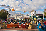 Bellmore, New York, U.S. 22nd September 2013. The Information Booth run by the Chamber of Commerce of the Bellmores is at the center of activity at the 27th Annual Bellmore Family Street Festival, featuring family fun with exhibits and attractions in a 25 square block area, with over 120,000 people expected to attend over the weekend.