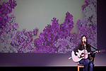 Zoe Buccella, a student at Ohio University Eastern Campus, sings and plays acoustic guitar at the International Women's Day Festival in Baker Ballroom on Sunday, March 19, 2017. © Ohio University / Photo by Kaitlin Owens