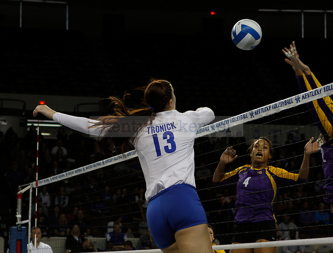 Kayla Tronick tricks LSU into thinking she was going to spike the ball down, but instead decides the send the ball to the back of the court gaining a point for UK in Lexington, Ky., Sunday, November 9th, 2013, by Emma Leggio | Staff.