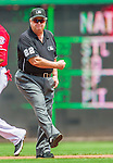 23 August 2015: MLB Umpire and Crew Chief Joe West signals an out at second during a game between the Milwaukee Brewers and the Washington Nationals at Nationals Park in Washington, DC. The Nationals defeated the Brewers 9-5 in the third game of their 3-game weekend series. Mandatory Credit: Ed Wolfstein Photo *** RAW (NEF) Image File Available ***