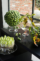 Strong sculptural statements can be made very simply; a circular arrangement of chicory has been tied with rough twine and a globe constructed with some Brussels sprouts