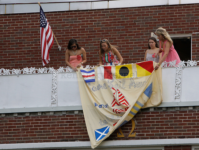 Members of the Chi Omega sorority hung a banner on their house at sorority bid day in Lexington, Ky., on Thursday, August 22, 2013. Photo by Tessa Lighty | Staff