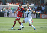 Chicago midfielder Marco Pappa (16) battles for the ball with LA Galaxy midfielder Juninho (19).  The LA Galaxy defeated the Chicago Fire 2-0 at Toyota Park in Bridgeview, IL on July 8, 2012.