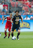 Philadelphia Union defender Danny Califf #4 and Toronto FC forward Nick Soolsma #18 in action during an MLS game between the Philadelphia Union and the Toronto FC at BMO Field in Toronto on May 28, 2011..
