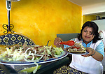 Mexico (04.04.2006)  A Mexican cook prepares tostadas of salpicon ( a fried tortilla seasoned with ripped meat, avocado, onion and chile)  in her stand in a Mexico City's restaurant, April 04, 2006.  Photo by © Javier Rodriguez/LATINPHOTO.org