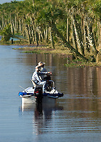 2 men fishing from a boat at the Stick Marsh by Felsmere, Florida on an April morin