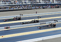 Apr. 14, 2012; Concord, NC, USA: NHRA top fuel dragster drivers (left to right) Terry McMillen , Khalid Albalooshi and Doug Kalitta race three wide during qualifying for the Four Wide Nationals at zMax Dragway. Mandatory Credit: Mark J. Rebilas-