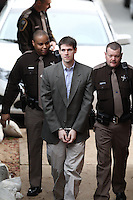 CHARLOTTESVILLE, VA - FEBRUARY 14: George Huguely is escorted to court as his trial in the death of former girlfriend Yeardley Love continues in Charlottesville, VA. Huguely was charged in the May 2010 death of his girlfriend Yeardley Love. She was a member of the Virginia women's lacrosse team. Huguely pleaded not guilty to first-degree murder. (Credit Image: © Andrew Shurtleff