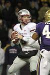 "Marshall Lobbestael (#8), Washington State quarterback, surveys the defense looking for an open receiver, while the Huskies Mason Foster (#40) applies pressure, during the Cougars Pac-10 conference ""Apple Cup"" showdown with arch-rival Washington at Husky Stadium in Seattle, Washington, on November 28, 2009.  The Cougars lost to the Huskies in the game, 30-0."