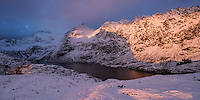 Vibrant winter light shines on mountains above lake Ågvatnet, Å I Lofoten, Moskenesøy, Lofoten Islands, Norway