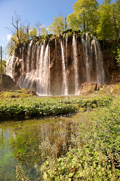 Waterfall over the travatines of Plitvice Lakes National Park, Croatia. UNESCO World Heritage Site