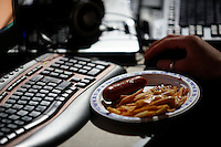 Fast food by keyboard. One of the world's largest convention of computer enthusiasts, simply called 'The Gathering'. Over five thousand young people come together each Easter, some travelling long distances, each carrying their own computer equipment to the massive Vikingship sports hall in the city of Hamar. The main activity is online gaming. Many hardly see daylight or taste fresh air for the entire five days as they compete with their fellow geeks for cash prizes and the honour of being the best.