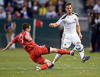Toronto FC midfielder Sam Cronin (2) pushes the ball away from advancing LA Galaxy midfielder Todd Dunivant (2). The LA Galaxy and Toronto FC played to a 0-0 draw at Home Depot Center stadium in Carson, California on Saturday May 15, 2010.  .