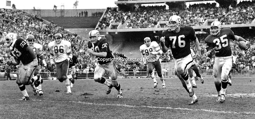 Raiders sweep..Gene Upshaw, Jim Oftto, Bob Svihus,  and Hewritt Dixon...against the Kansas City Chiefs in (1969 photo/Ron Riesterer)