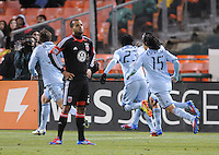 Sporting Kansas City forward C.J. Sapong (17) celebrates with teammates his score in the 90th of the game while D.C. United Maicon Santos looks at the score board. Sporting Kansas City defeated D.C. United  1-0 at RFK Stadium, Saturday March 10, 2012.