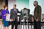 Ohio University's Interim President, David Descutner, center, and 2013 Distinguished Professor recipient, Dr. Tom Carpenter, right, unveil the 2017 Distinguished Professor portrait of Dr. Judith Yaross Lee at Ohio University's Baker Center Ballroom on Monday, February 20, 2017.