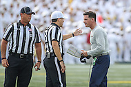 Annapolis, MD - September 9, 2016: Connecticut Huskies head coach Bob Diaco talks to the referee during game between UConn and Navy at  Navy-Marine Corps Memorial Stadium in Annapolis, MD. September 9, 2016.  (Photo by Elliott Brown/Media Images International)
