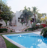 The private wing of the house faces onto the limestone courtyard and the swimming pool