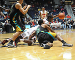 "Ole Miss' Murphy Holloway (31) vs. Coastal Carolina's Justin Daniel (20) at the C.M. ""Tad"" Smith Coliseum in Oxford, Miss. on Tuesday, November 13, 2012. (AP Photo/Oxford Eagle, Bruce Newman)"