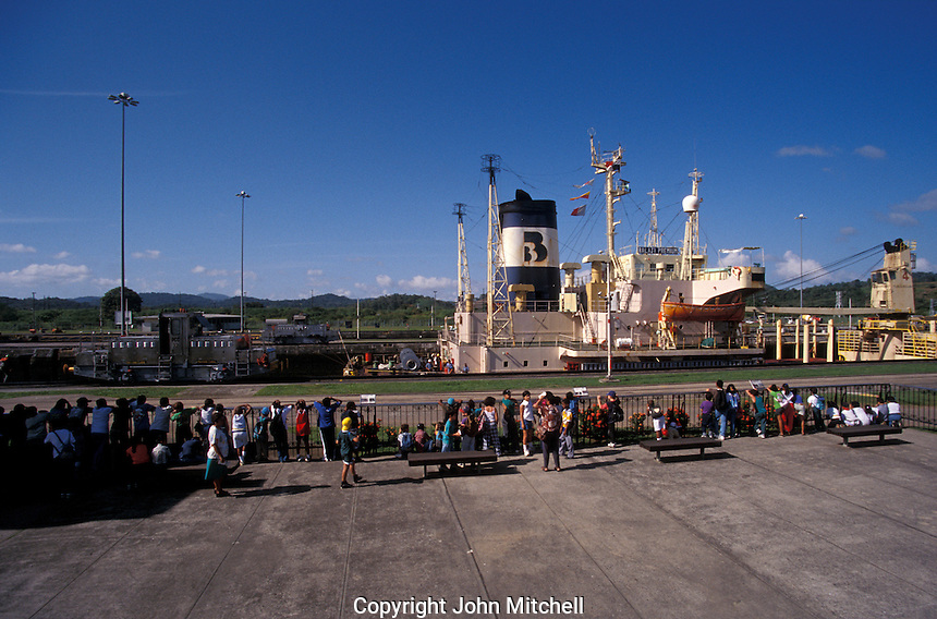 Panamanian school children watching a freightor pass through  Miraflores locks in the Panama Canal