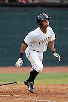 Left fielder Enyel Vallejo (12) of the Bristol Pirates bats in a game against the Greeneville Astros on Saturday, July 26, 2014, at DeVault Memorial Stadium in Bristol, Virginia. Greeneville won, 2-1 in Game 1 of a doubleheader. (Tom Priddy/Four Seam Images)