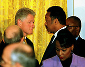United States President Bill Clinton speaks with Reverend Jesse Jackson after the annual prayer breakfast in the East Room of the White House September 11, 1998 in Washington, DC. Reading from notes as his hushed audience of more than 100 ministers, priests and other religious leaders listened, the president said he had a broken spirit but still hoped to redeem the nation's trust. .Credit: Richard Ellis / Pool via CNP