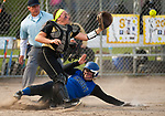 WATERBURY,  CT-051117JS14- Crosby's Kassandra Elezi (16) slides in to score in front of the tag by WCA's Gabie Rocco  (20) during their game Thursday at Huntingdon Park in Waterbury. <br />  Jim Shannon Republican-American